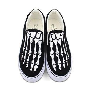 NWT skeleton feet slip-on vans